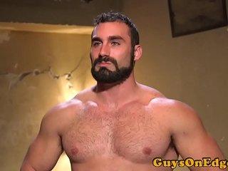 BDSM hunk edging while masked doms jerk cock