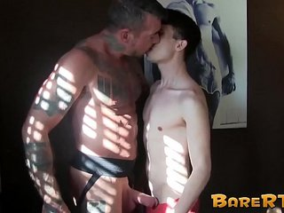 Skinny twink roughly bare fucked by a tattooed hunk