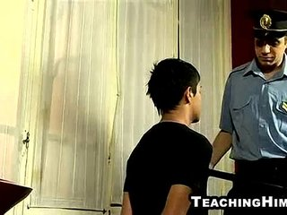 Young hunk sucking on a police officer's cock